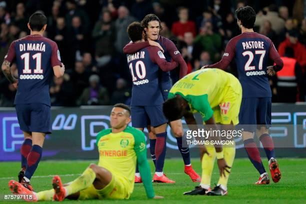 Paris SaintGermain's Uruguayan forward Edinson Cavani celebrates with Paris SaintGermain's Brazilian forward Neymar and teammates after he opened the...