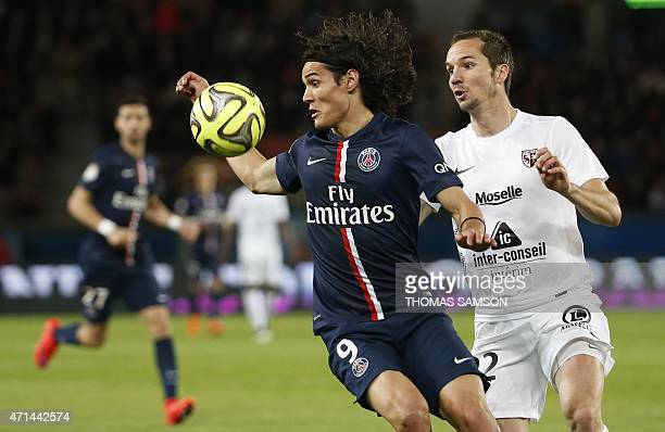 Paris SaintGermain's Uruguayan forward Edinson Cavani challenges Metz's French midfielder Kevin Lejeune during the French L1 football match between...