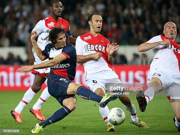 Paris SaintGermain's Uruguayan forward Edinson Cavani challenges Monaco's Portuguese defender Ricardo Carvalho and Monaco's Danish midfielder Jakob...