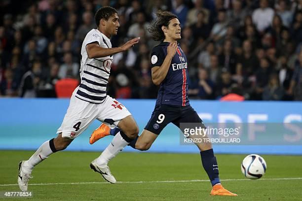 Paris SaintGermain's Uruguayan forward Edinson Cavani challenges Bordeaux's defender Pablo during the French L1 football match between Paris...