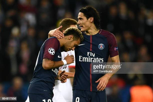 Paris SaintGermain's Uruguayan forward Edinson Cavani comforts Paris SaintGermain's Brazilian forward Neymar during the UEFA Champions League...