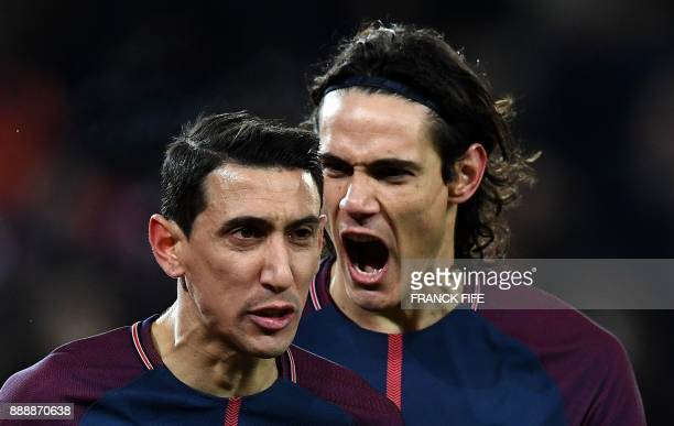 TOPSHOT Paris SaintGermain's Uruguayan forward Edinson Cavani congratulates Paris SaintGermain's Argentinian forward Angel Di Maria after he scored...