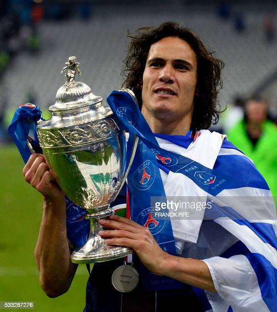 TOPSHOT Paris SaintGermain's Uruguayan forward Edinson Cavani holds the trophy as he celebrates after winning the French Cup final football match...
