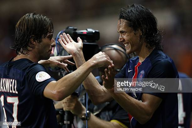 Paris SaintGermain's Uruguayan forward Edinson Cavani is congratulated by his teammate Brazilian defender Maxwell after scoring a goal during the...