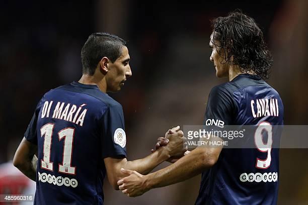 Paris SaintGermain's Uruguayan forward Edinson Cavani is congratulated by Paris SaintGermain's Argentinian forward Angel Di Maria after scoring his...