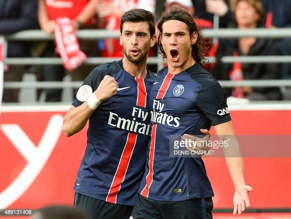 Paris SaintGermain's Uruguayan forward Edinson Cavani is congratulated by his teammate on scoring during the French Ligue 1 football match between...