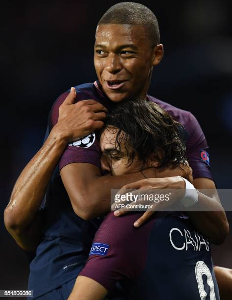 Paris SaintGermain's Uruguayan forward Edinson Cavani is congratulated by Paris SaintGermain's French forward Kylian Mbappe after scored a goal...