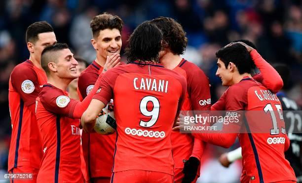 Paris SaintGermain's Uruguayan forward Edinson Cavani is congratuled by teammates after scoring a goal during the French L1 football match between...