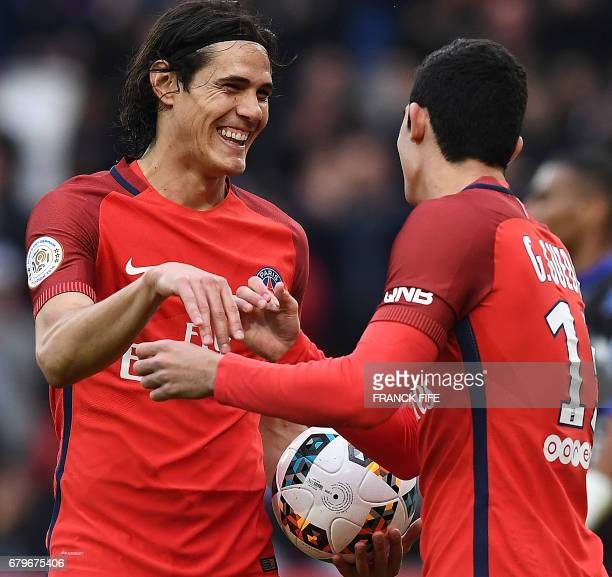 Paris SaintGermain's Uruguayan forward Edinson Cavani is congratuled by teammates Paris SaintGermain's Portuguese forward Goncalo Guedes after...