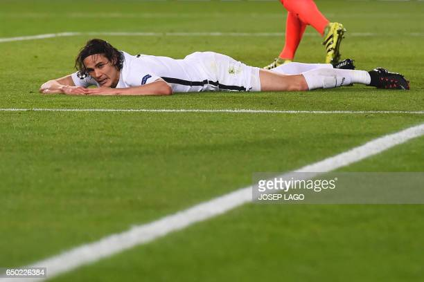 Paris SaintGermain's Uruguayan forward Edinson Cavani lies on the pitch during the UEFA Champions League round of 16 second leg football match FC...