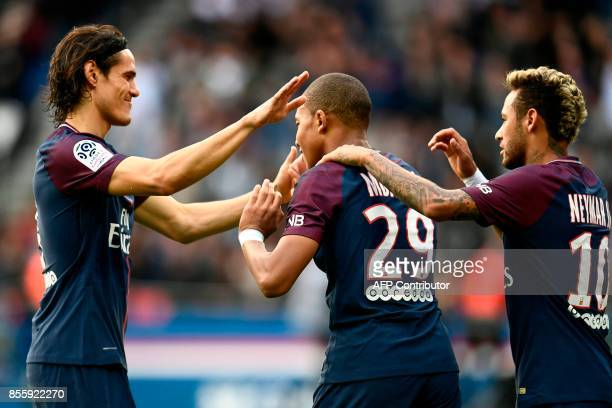Paris SaintGermain's Uruguayan forward Edinson Cavani Paris SaintGermain's French forward Kylian Mbappe and Paris SaintGermain's Brazilian forward...