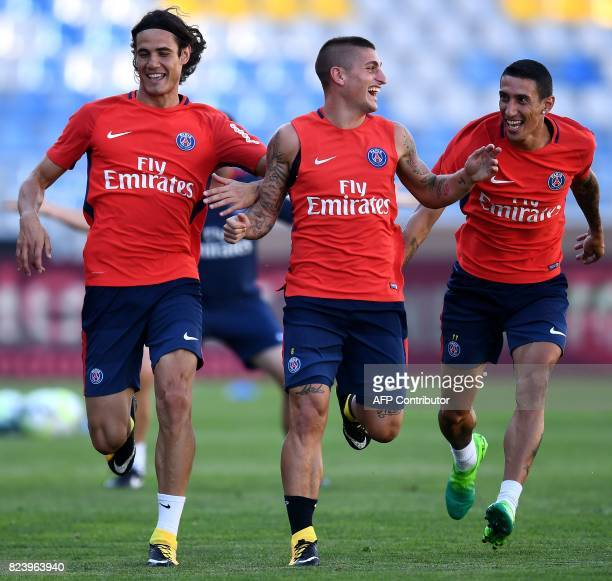 Paris SaintGermain's Uruguayan forward Edinson Cavani Paris SaintGermain's Italian midfielder Marco Verratti and Paris SaintGermain's Argentinian...