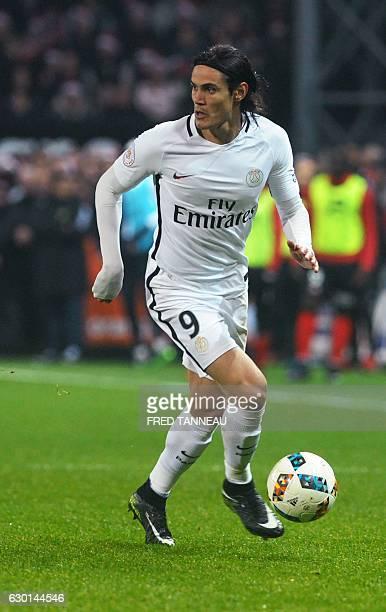 Paris SaintGermain's Uruguayan forward Edinson Cavani plays the ball during the French Ligue 1 football match Guingamp against PSG on December 17...