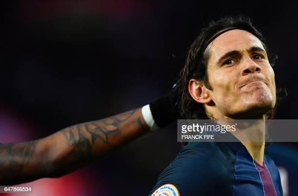 TOPSHOT Paris SaintGermain's Uruguayan forward Edinson Cavani reacts after scoring a goal during the French L1 football match between Paris...