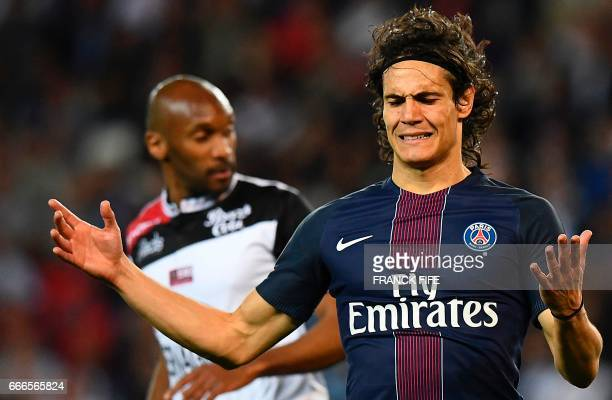 Paris SaintGermain's Uruguayan forward Edinson Cavani reacts after missing a goal during the French L1 football match between Paris SaintGermain and...
