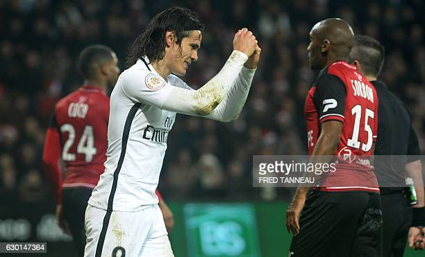 Paris SaintGermain's Uruguayan forward Edinson Cavani reacts at the end of the French L1 football match Guingamp against PSG on December 17 2016 at...