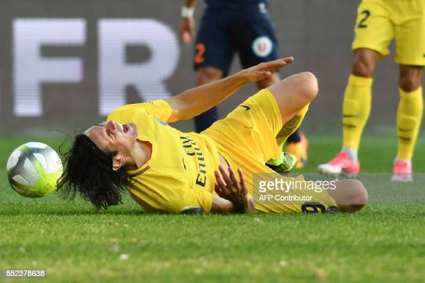 Paris SaintGermain's Uruguayan forward Edinson Cavani reacts in pain after being fouled during the French Ligue 1 football match between Paris...