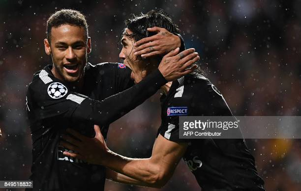 Paris SaintGermain's Uruguayan forward Edinson Cavani reacts with Paris SaintGermain's Brazilian forward Neymar after scoring a goal during the UEFA...