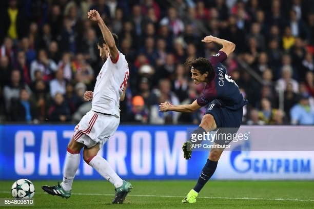 Paris SaintGermain's Uruguayan forward Edinson Cavani scores a goal during the UEFA Champions League football match between Paris SaintGermain and...