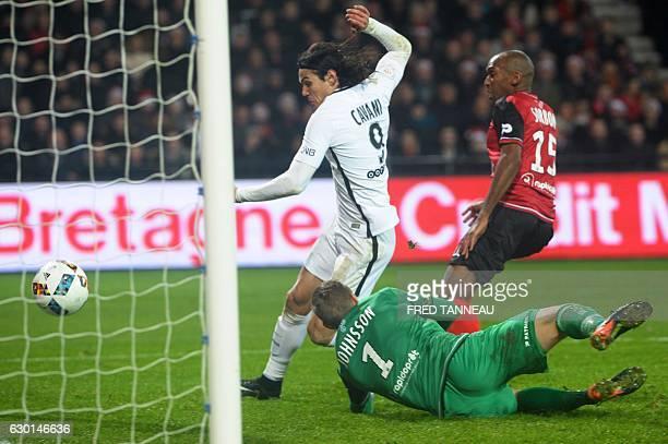Paris SaintGermain's Uruguayan forward Edinson Cavani scores during the French L1 football match Guingamp against PSG on December 17 2016 at the...
