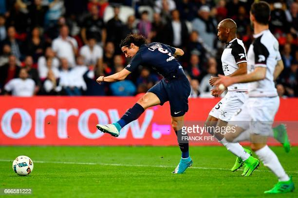 Paris SaintGermain's Uruguayan forward Edinson Cavani scores his second goal during the French L1 football match between Paris SaintGermain and...