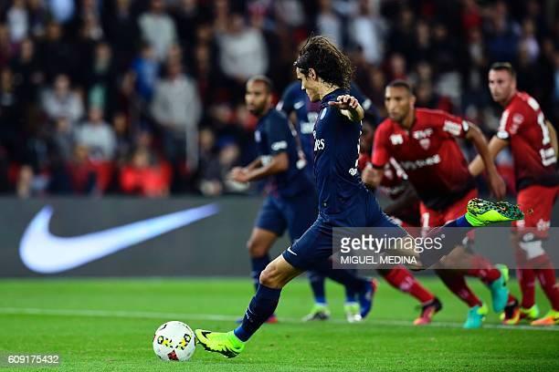Paris SaintGermain's Uruguayan forward Edinson Cavani shoots and scores a penalty during the French L1 football match between Paris SaintGermain and...