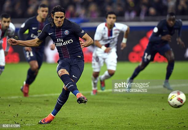 Paris SaintGermain's Uruguayan forward Edinson Cavani shoots and scores a penalty during French L1 football match between Olympique Lyonnais and...