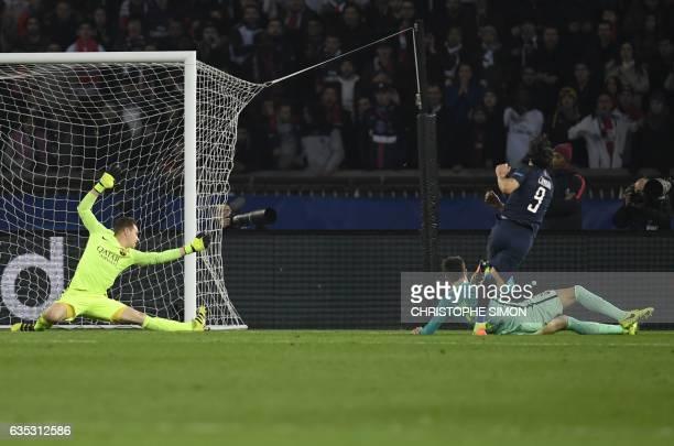 TOPSHOT Paris SaintGermain's Uruguayan forward Edinson Cavani shoots and scores despite of Barcelona's German goalkeeper MarcAndre Ter Stegen during...