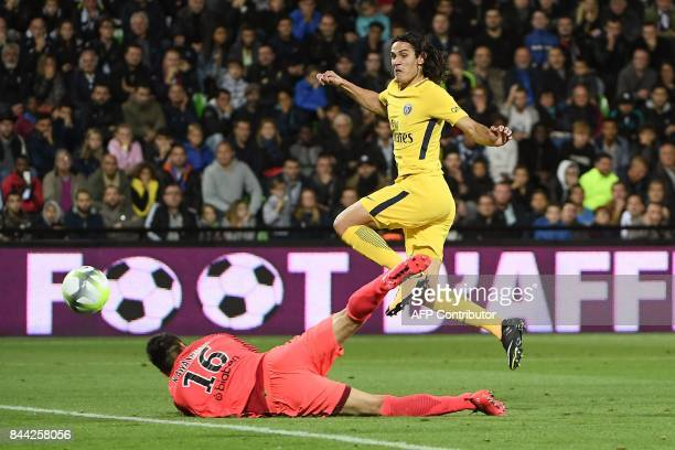 Paris SaintGermain's Uruguayan forward Edinson Cavani shoots on goal over Metz's Japanese goalkeeper Eiji Kawashima during the French L1 football...
