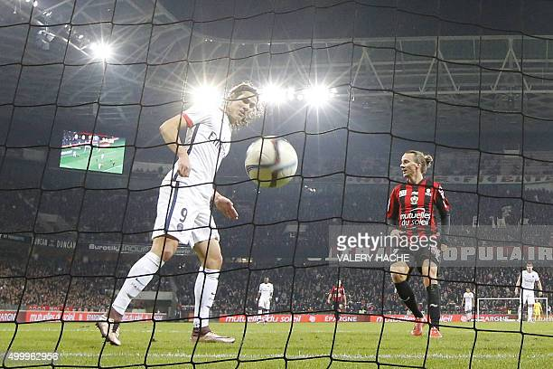 Paris SaintGermain's Uruguayan forward Edinson Cavani shoots to scores a goal during the French L1 football match Nice vs Paris SaintGermain on...
