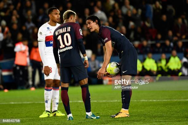 TOPSHOT Paris SaintGermain's Uruguayan forward Edinson Cavani speaks with Paris SaintGermain's Brazilian forward Neymar during the French L1 football...