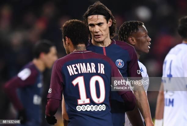 Paris SaintGermain's Uruguayan forward Edinson Cavani speaks with Paris SaintGermain's Brazilian forward Neymar prior to kick a penalty during the...