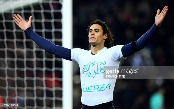 TOPSHOT Paris SaintGermain's Uruguayan forward Edinson Cavani takes off his jersey as he celebrates his goal during the French L1 football match...