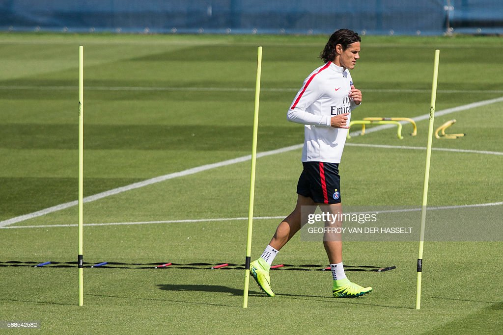 Paris SaintGermain's Uruguayan forward Edinson Cavani takes part in a training session at the CampdesLoges in SaintGermainenLaye west of Paris on...