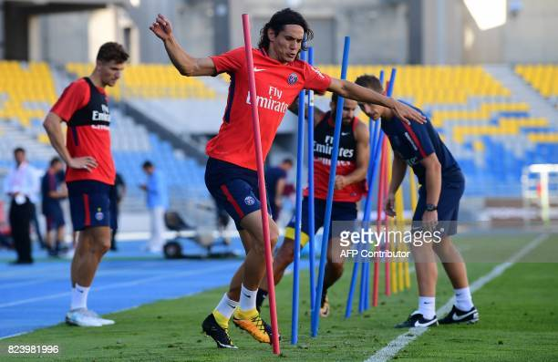 Paris SaintGermain's Uruguayan forward Edinson Cavani takes part in a training session at the Grand Stade in Tangiers on July 28 2017 on the eve of...
