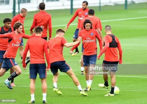 Paris SaintGermain's Uruguayan forward Edinson Cavani takes part in a training session at the Camp des Loges in SaintGermainenLaye near Paris on...