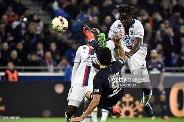 Paris SaintGermain's Uruguayan forward Edinson Cavani tries to score a goal as Lyon's French defender Mapou YangaMbiwa attempts to stop him during...