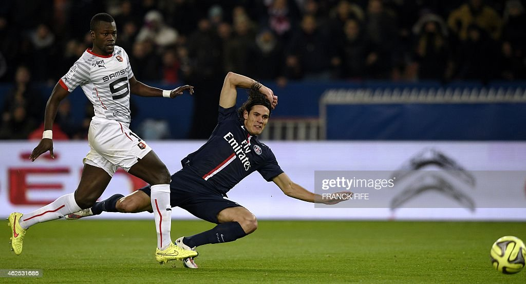 Paris Saint-Germain's Uruguayan forward <a gi-track='captionPersonalityLinkClicked' href=/galleries/search?phrase=Edinson+Cavani&family=editorial&specificpeople=4104253 ng-click='$event.stopPropagation()'>Edinson Cavani</a> (R) vies for the ball with Rennes' Senegalese defender Fallou Diagne during the French L1 football match between Paris Saint-Germain (PSG) and Rennes (SR) at the Parc des Princes stadium in Paris on January 30, 2015.