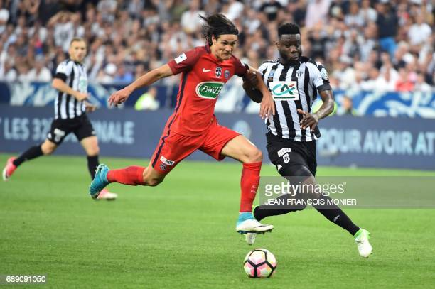 TOPSHOT Paris SaintGermain's Uruguayan forward Edinson Cavani vies for the ball with Angers' Ivorian defender Ismael Traore during the French Cup...