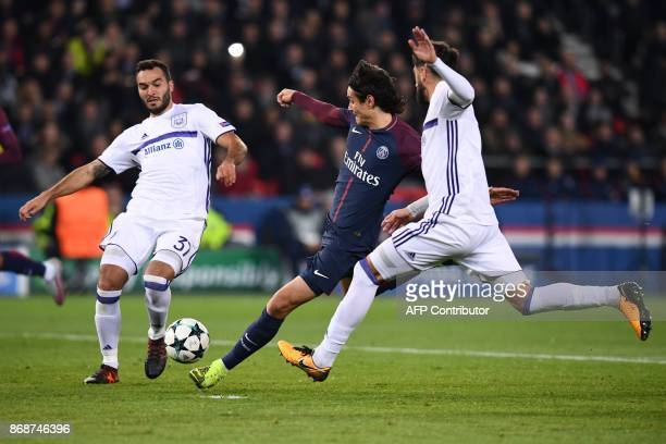 Paris SaintGermain's Uruguayan forward Edinson Cavani vies for the ball with Anderlecht's Serbian defender Ivan Obradovic and Anderlecht's Portuguese...