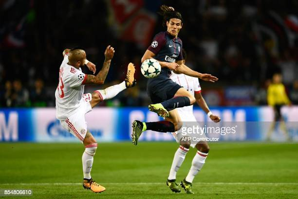Paris SaintGermain's Uruguayan forward Edinson Cavani vies with Bayern Munich's Chilean midfielder Arturo Vidal during the UEFA Champions League...