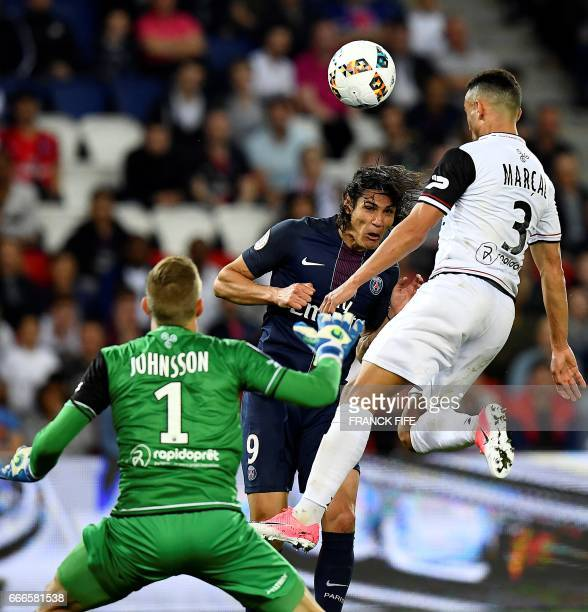 Paris SaintGermain's Uruguayan forward Edinson Cavani vies with Guingamp's defender Fernado Marcal de Olivieira and Guingamp's Danish goalkeeper...