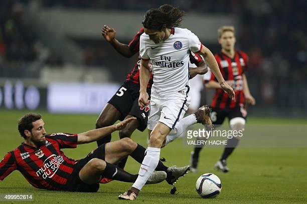 Paris SaintGermain's Uruguayan forward Edinson Cavani vies with Nice's French defender Paul Baysse during the French L1 football match Nice vs Paris...