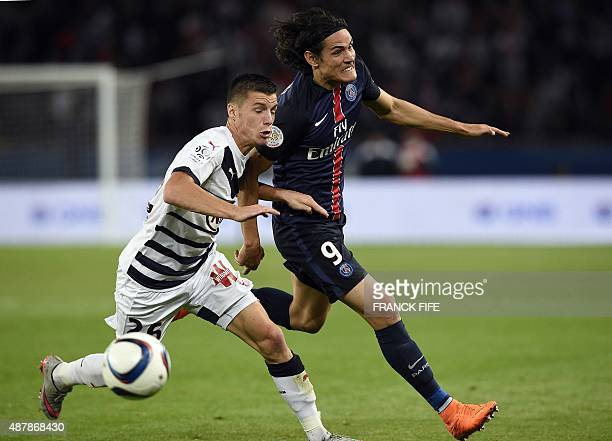 Paris SaintGermain's Uruguayan forward Edinson Cavani vies with Bordeaux's French defender Frederic Guilbert during the French L1 football match...