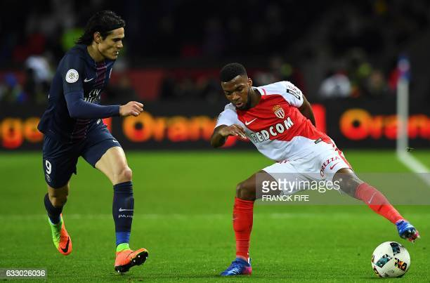 TOPSHOT Paris SaintGermain's Uruguayan forward Edinson Cavani vies with Monaco's French midfielder Thomas Lemar during the French L1 football match...