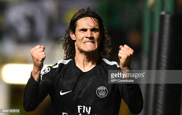 Paris SaintGermain's Uruguayan striker Edinson Cavani celebrates after scoring his second goal their fifth during the UEFA Champions League Group B...