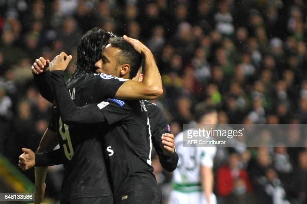 Paris SaintGermain's Uruguayan striker Edinson Cavani celebrates with Paris SaintGermain's Brazilian striker Neymar after scoring their third goal...