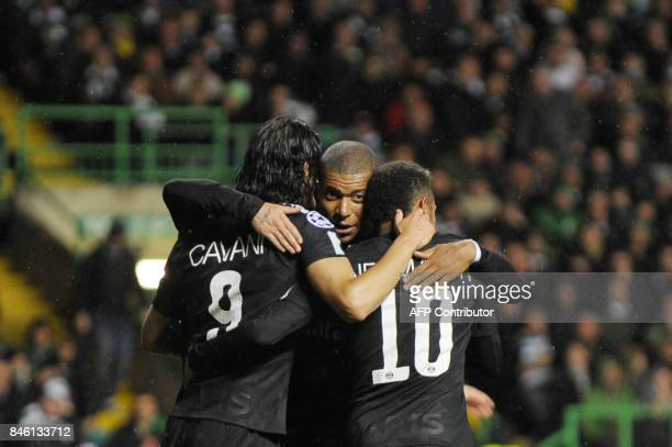Paris SaintGermain's Uruguayan striker Edinson Cavani celebrates with Paris SaintGermain's French striker Kylian Mbappe and Paris SaintGermain's...