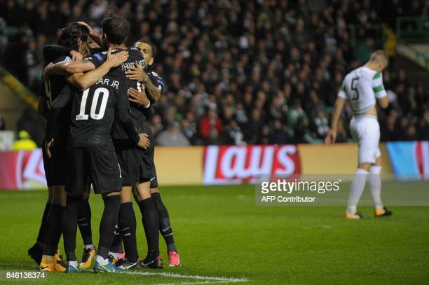 Paris SaintGermain's Uruguayan striker Edinson Cavani celebrates with teammates after scoring their third goal from the penalty spot during the UEFA...