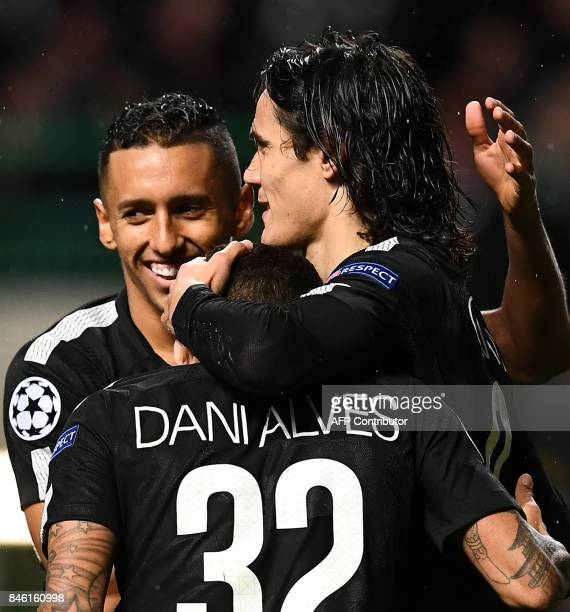 Paris SaintGermain's Uruguayan striker Edinson Cavani celebrates with teammates after scoring his second goal their fifth during the UEFA Champions...